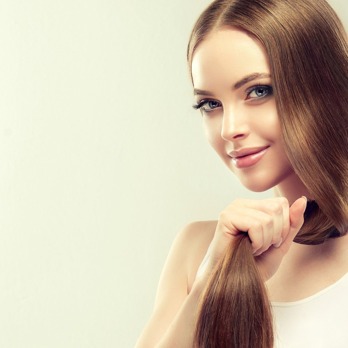 Woman holding straight hair